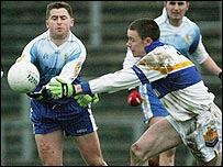 Conleth Gilligan of Ballinderry in action against Cormac McGinley