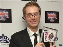 Stephen Merchant posing with his Best Actor Award