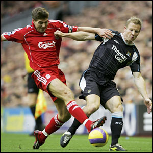 Liverpool's Steven Gerrard and Ben Thatcher of Manchester City