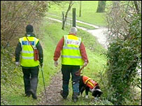 Two rescue team members with a search dog