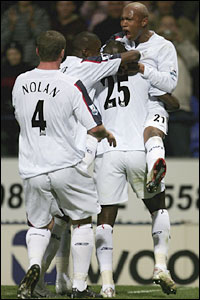 El Hadji Diouf of Bolton Wanderers celebrates with goal scorer Abdoulaye Faye (25)