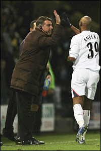 Nicolas Anelka high-fives Sam Allardyce