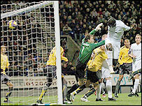 Abdoulaye Faye is allowed a free header at the near post to put Bolton ahead against Arsenal