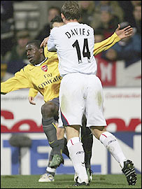Bolton striker Kevin Davies clashes with Emanuel Eboue
