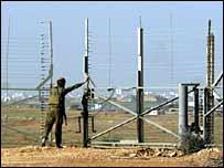 Israeli soldier shuts gate just outside Gaza