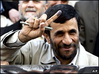 Mahmoud Ahmadinejad shows his ink-stained finger after voting