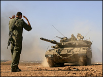 Israeli tank arrives at a base in southern Israel after leaving the Gaza Strip