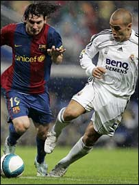 Barcelona's Lionel Messi and Real Madrid's Fabio Cannavaro
