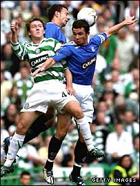 Celtic's Aiden McGeady challenges for the ball with Rangers captain Barry Ferguson and Alan Hutton
