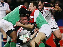Ulster's Justin Fitzpatrick is tackled by Mike Catt (right) and Delon Armitage