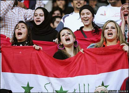 Iraqi supporters sing prior to the gold medal match between Qatar and Iraq