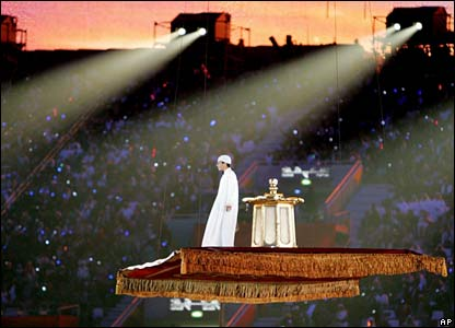 A young boy rides a flying carpet during the closing ceremony at the end of the 15th Asian Games in Doha, 15 December 2006. The Games, which have been the biggest ever staged, officially end tonight a