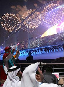 Spectators watch as fireworks explode during the closing ceremony of the 15th Asian Games.