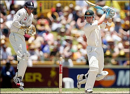 Michael Clarke carves a ball to the boundary