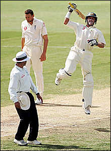 Micahel Hussey celebrates scoring his century