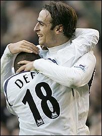 Dimitar Berbatov (right) hugs Jermain Defoe during a good win for Spurs against Wigan