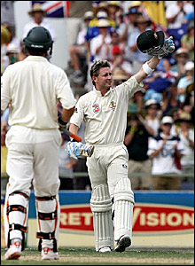 Michael Clarke (right) acknowledges the crowd after scoring a century