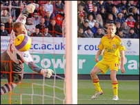 Craig Bellamy watches the ball after volleying in for Liverpool in their 3-0 win at Charlton