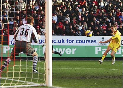 Craig Bellamy blasts the ball past Thomas Myhre