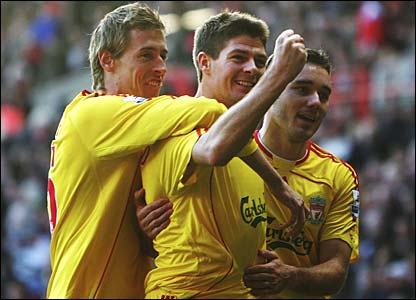 Peter Crouch and Fabio Aurelio congratulate Steven Gerrard