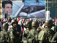 Lebanese soldiers in front of Pierre Gemayel poster