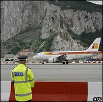 A policeman looks on as an Iberia flight lands in Gibraltar