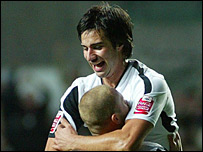 Rory Fallon and Lee Trundle celebrate Swansea's goal glut
