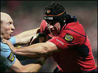 Denis Leamy (right) tries to fend off Tom Shanklin