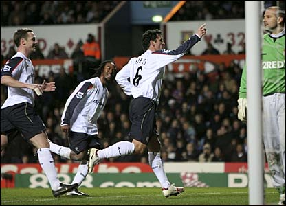 Gary Speed celebrates after scoring a penalty