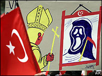 Banners held up to protest against the Pope's visit to Turkey