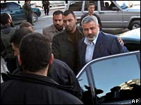 Ismail Haniya (centre) surrounded by bodyguards arrives for a cabinet meeting