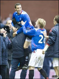 Hemdani celebrates with the Rangers bench after his late leveller