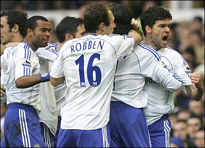 Michael Ballack is mobbed by his team-mates