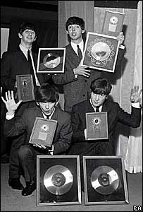 The Beatles in 1963 with several silver discs