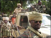 Chadian soldiers patrol the south-eastern town of Am Timan on 27 October 2006 after it was briefly occupied by rebels