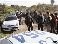 Greek police investigate the scene of the killings