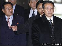 North Korean envoy Kim Kye-gwan (right) and his delegation on 18 December 2006