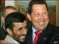 Mahmoud Ahmadinejad (l) and Hugo Chavez