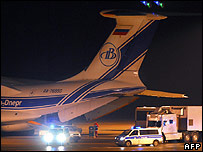Container of uranium being loaded onto Russian plane at Dresden airport