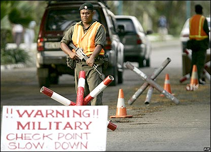Soldiers man a military checkpoint in Fiji's capital Suva on 7 December 2006