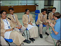 Students talking to science section team in Malaysia
