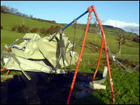 A mobile building was blown 100 metres over the rail line onto a children's swing