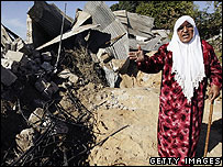 Palestinian woman reacts to destruction of her home in Jabaliya