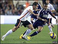 Valencia's defender Curro Torres (L) vies for the ball with Real Madrid Brazilian striker Robinho