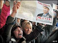 Mr Seselj's supporters hold his picture at a rally in Belgrade on 23 November 2006