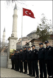 Turkish policemen gather in front of the Haghia Sophia museum in Istanbul on 27 November