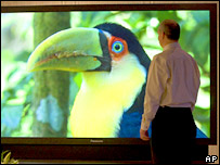 Man watches plasma screen. Image: AP