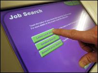 A man doing a computer job search