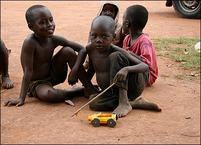 Children playing with a home-made toy car [Pic: Eddie Mackle]
