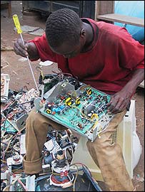 Boy extracting wiring from e-waste (Photos Copyright Basel Action Network)